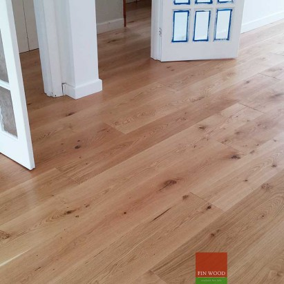 Fitting wide oak boards engineered London By Fin Wood #CraftedForLife #CraftedForLife