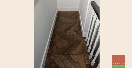 Beautiful Dark Oak Chevron Parquet Wooden Floor Fitted With A Single Row Border