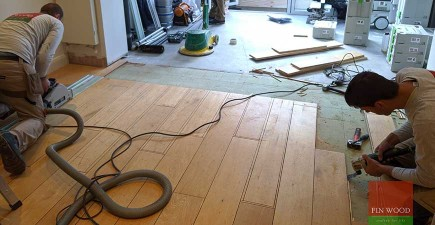 New engineered oak floor made to seamlessly match old refurbished boards