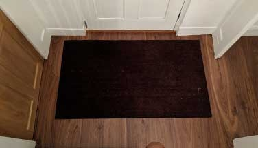 Integrated Doormat in wood flooring