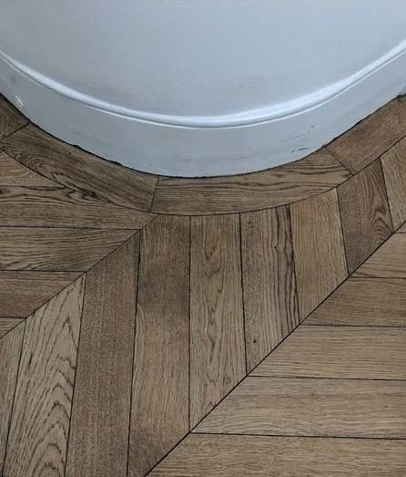 Herringbone parquet with curved borders