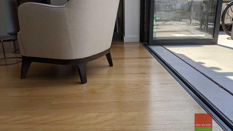 Wood floor joining to bifold door in wood flooring by Fin Wood Ltd #CraftedForLife